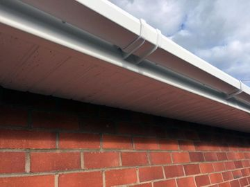 close up view of gutter installation by d richards roofing